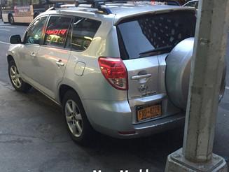 Parking Fail: One Wheel On The Curb