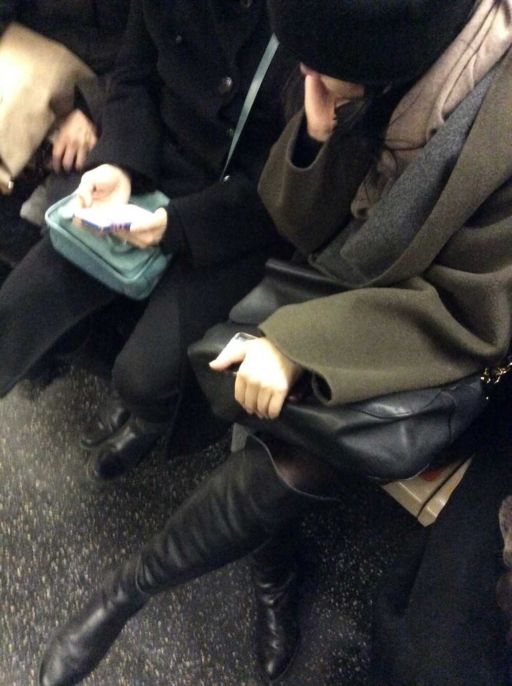 girl blocking train aisle with her crossed legs