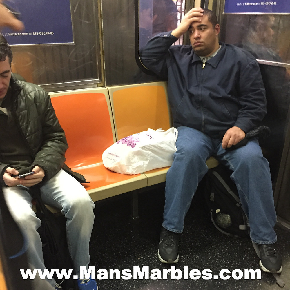 Stressed seat hog stares down commuter for getting too close to his third hogged seat