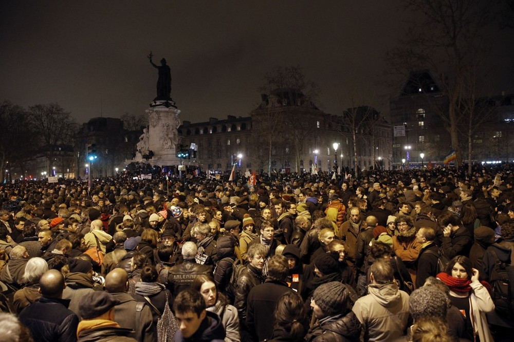 Demonstrators gather at the Place de la Republique after a shooting at a French satirical newspaper in Paris.