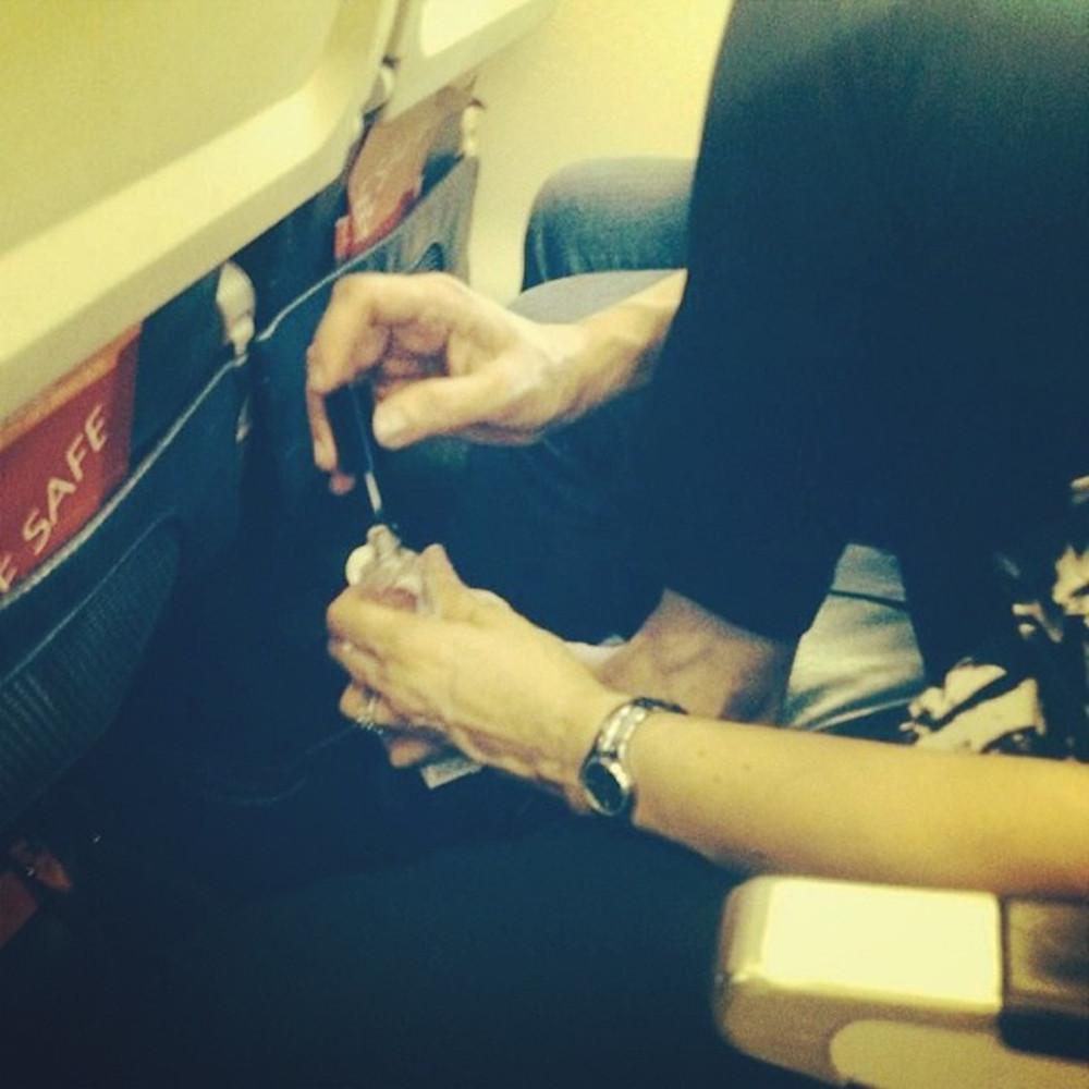 Passenger Shaming, woman painting her gross toenails on the plane