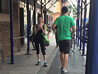 Woman Annoys Dozens of Passersby While Texting Mid Sidewalk
