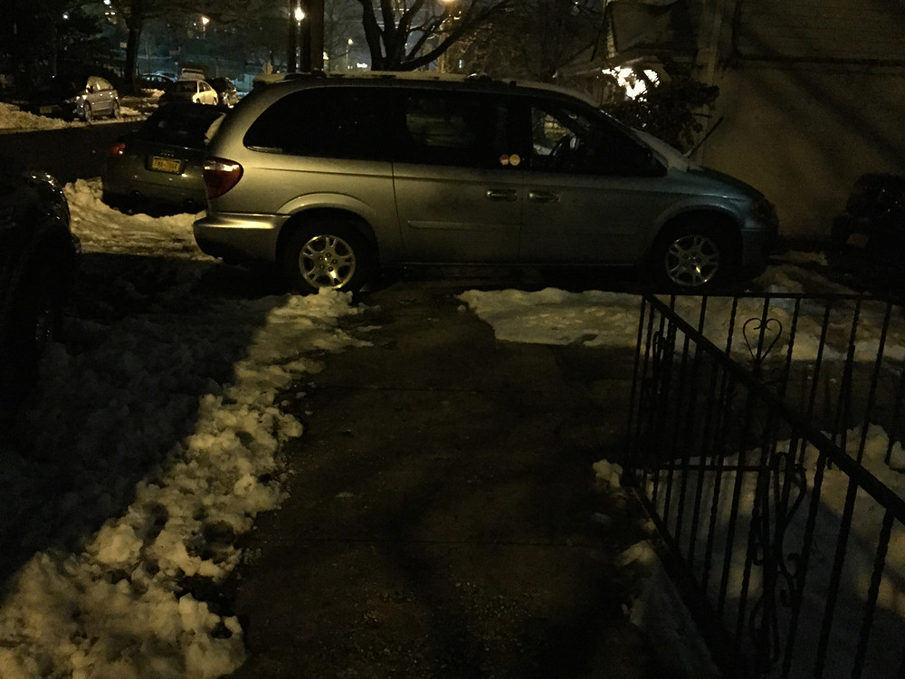 Van blocking the sidewalk and forcing to walk around it in the snow