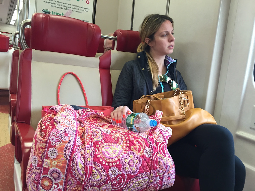 Womanspreading multiple bags on train seat even though there's a bag rack above her #4