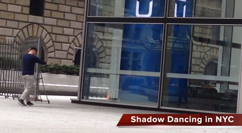 Shadow dancing with reflection at one chase manhattan plaza in nyc