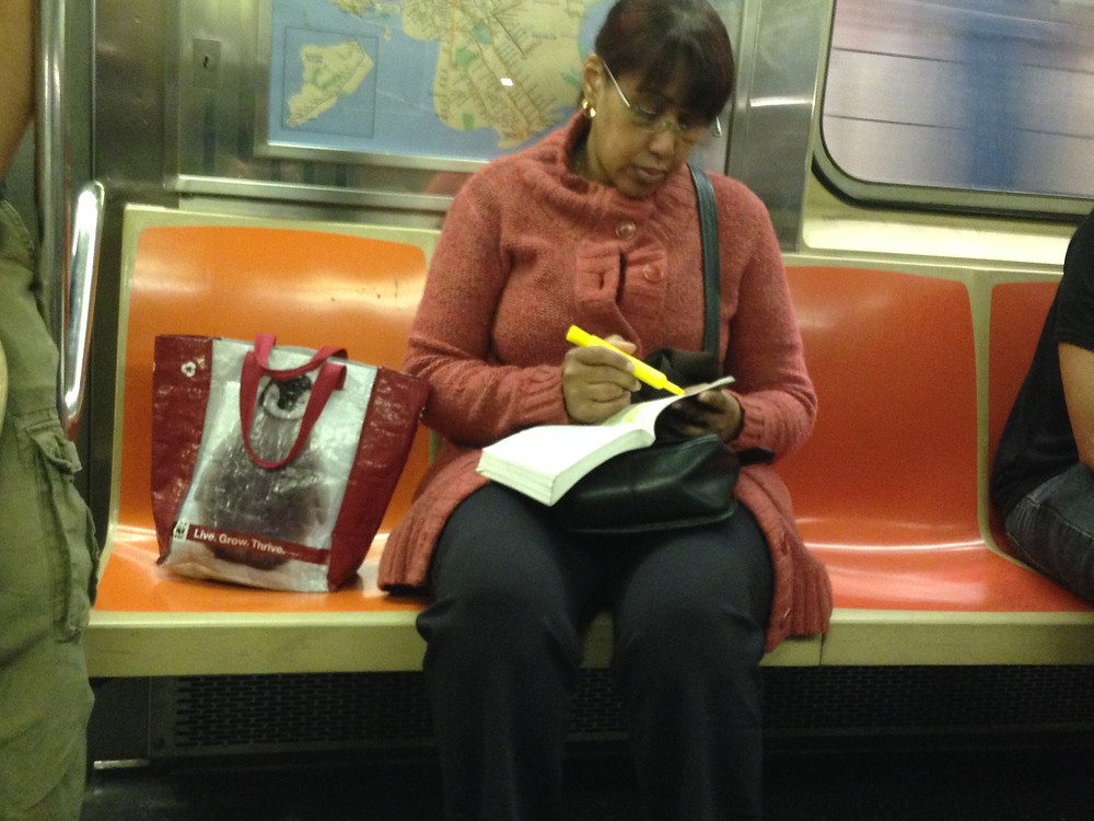 Bagspreading woman highlighting a book #1