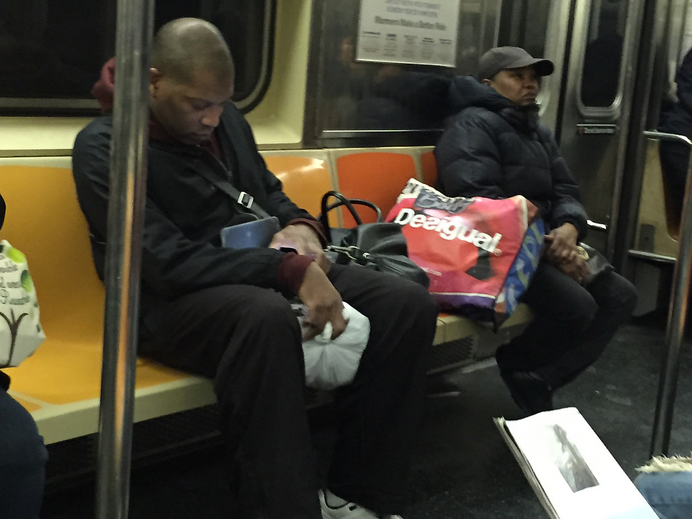 2 people taking up 4 seats on the 1 train in NYC by bagspreading #1