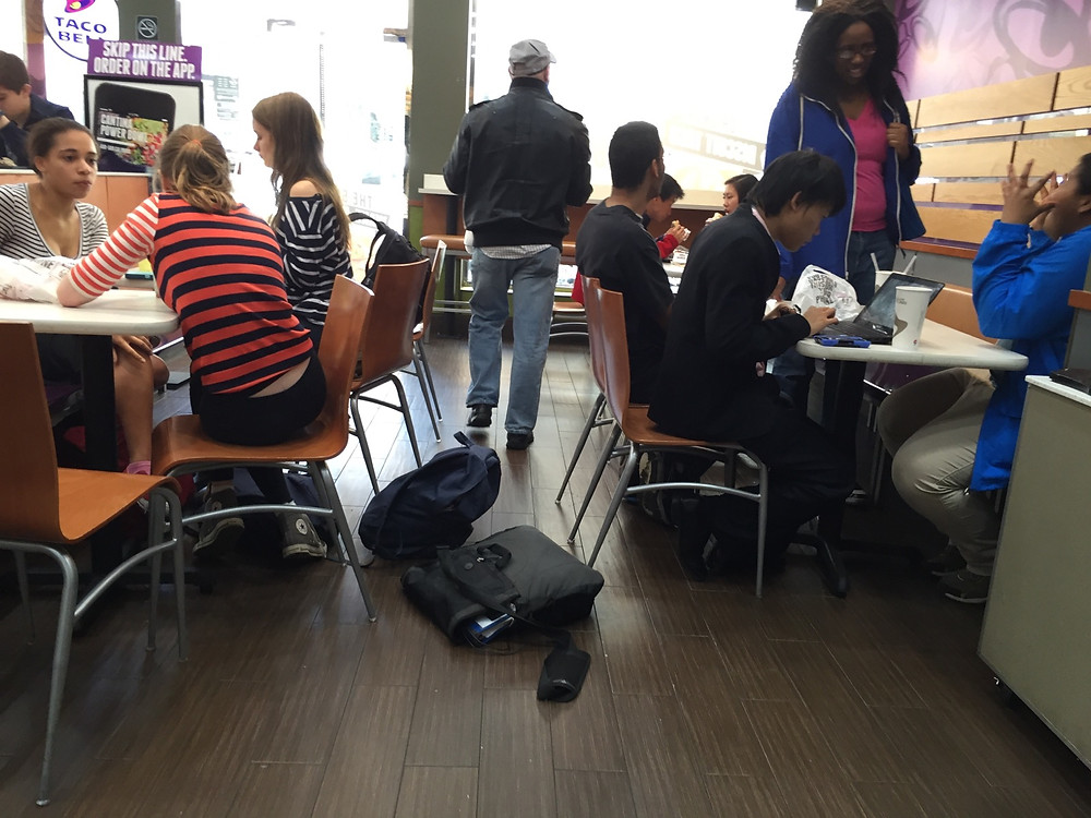 Students bagpreading on the floor in Taco Bell, forces man to step over them #4