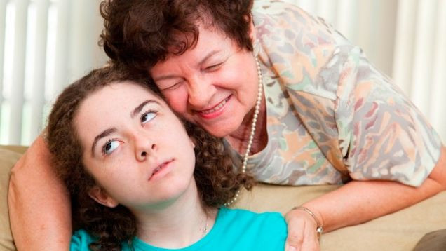 Annoyed teen rolling her eyes puts up with a ug from mom