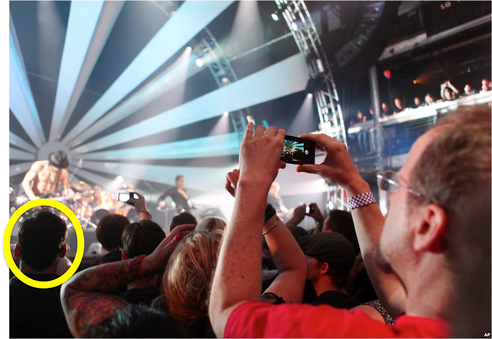 Man shooting video at a concert captures another man forced to watch with his own eyes