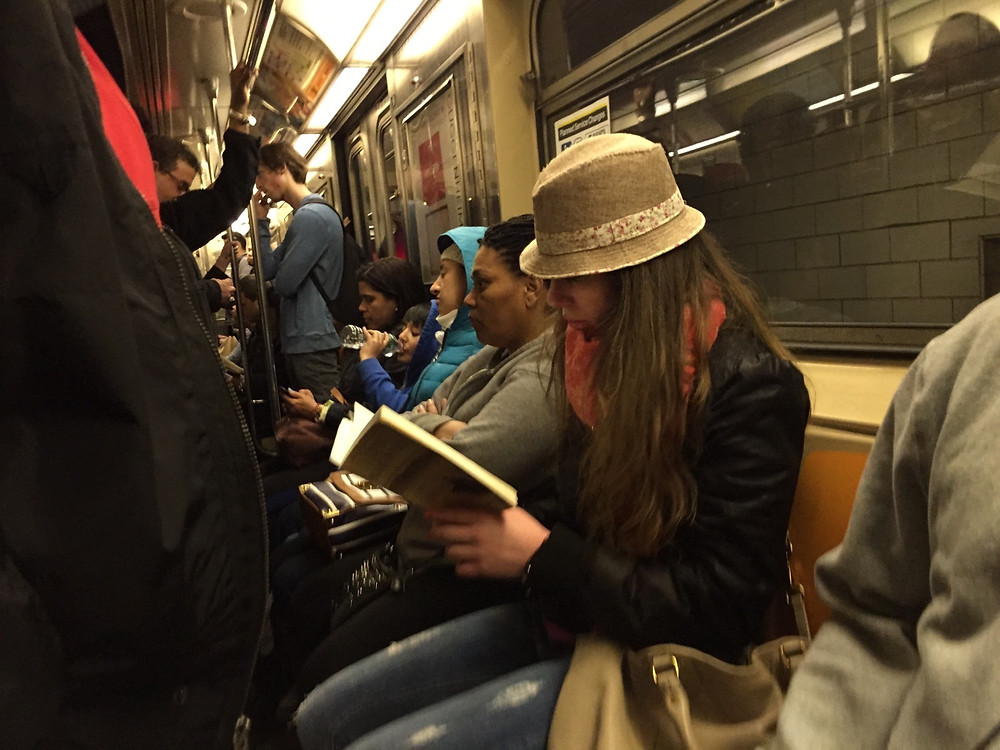 reading a book while womanspreading on a packed NYC train #7
