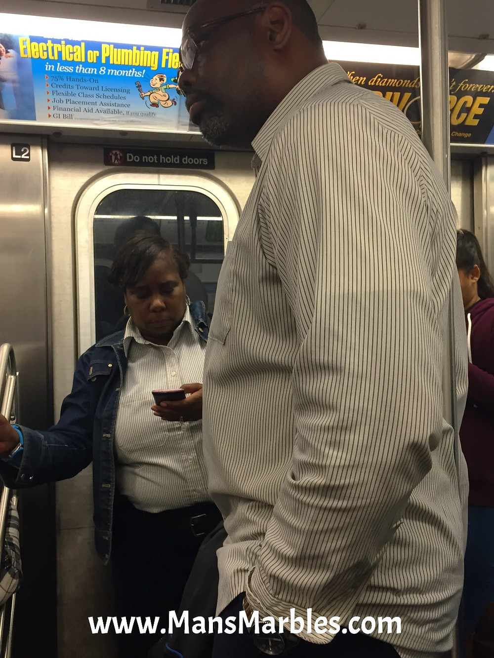 Pole Hugger on NYC Subway Train