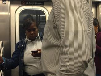 Pole Hugger on a NYC Subway Train