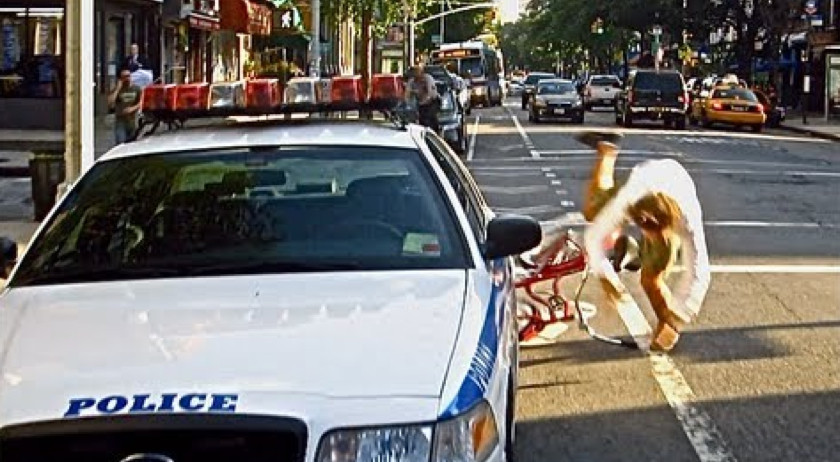 Casey Neistat riding a bike, crashing into a police car obstructing the bike lane