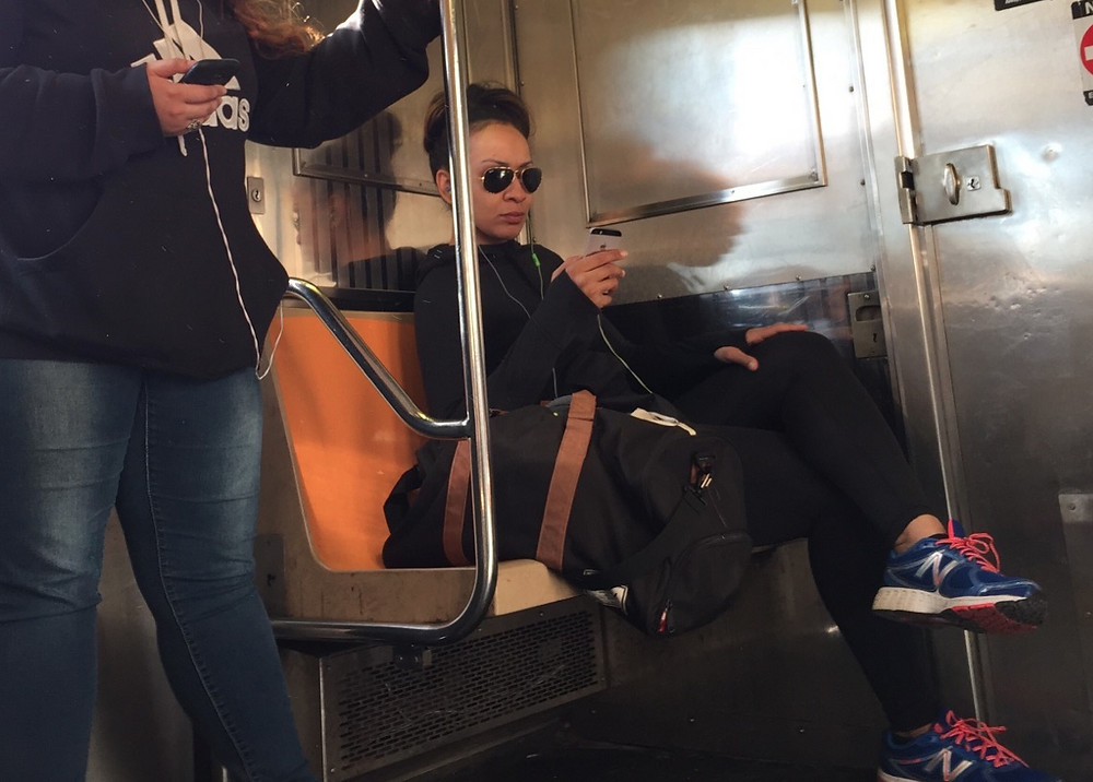Tough looking girl Womanspreading on the 1 train #2