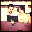 Couple in bed reading about sex, Sex Etiquette Poll Category