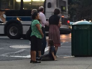 Nanny Chats on Phone While Kid Plays on Dirty NYC Sidewalk picture 3