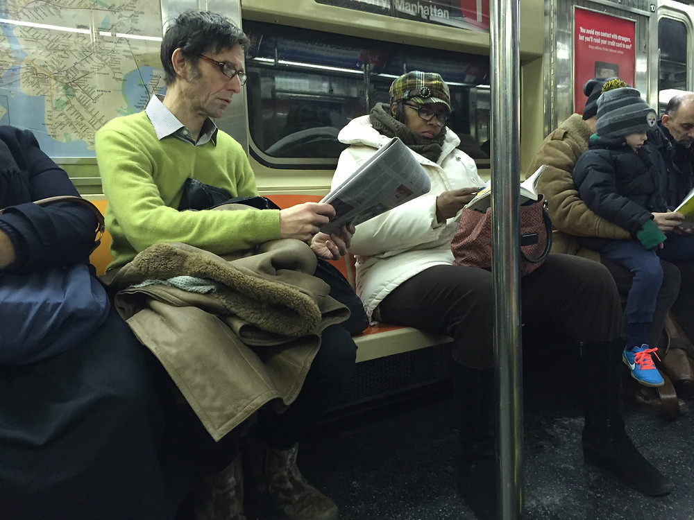 Man hogging a seat with his bag and a woman manspreading on NYC 1 train 3