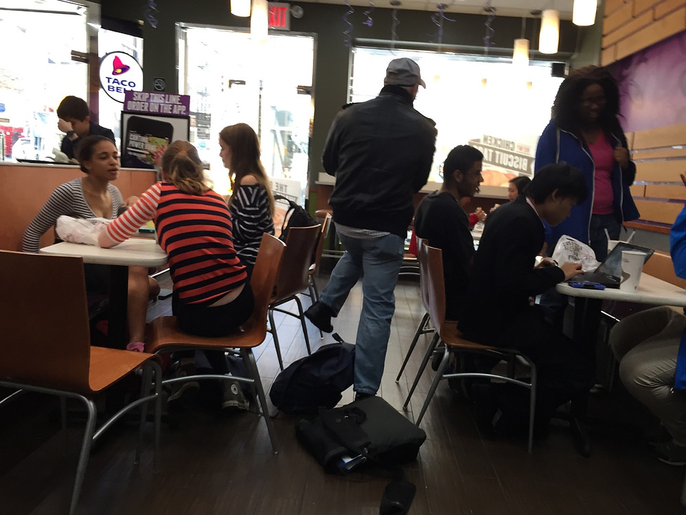 Students bagpreading on the floor in Taco Bell, forces man to step over them #2