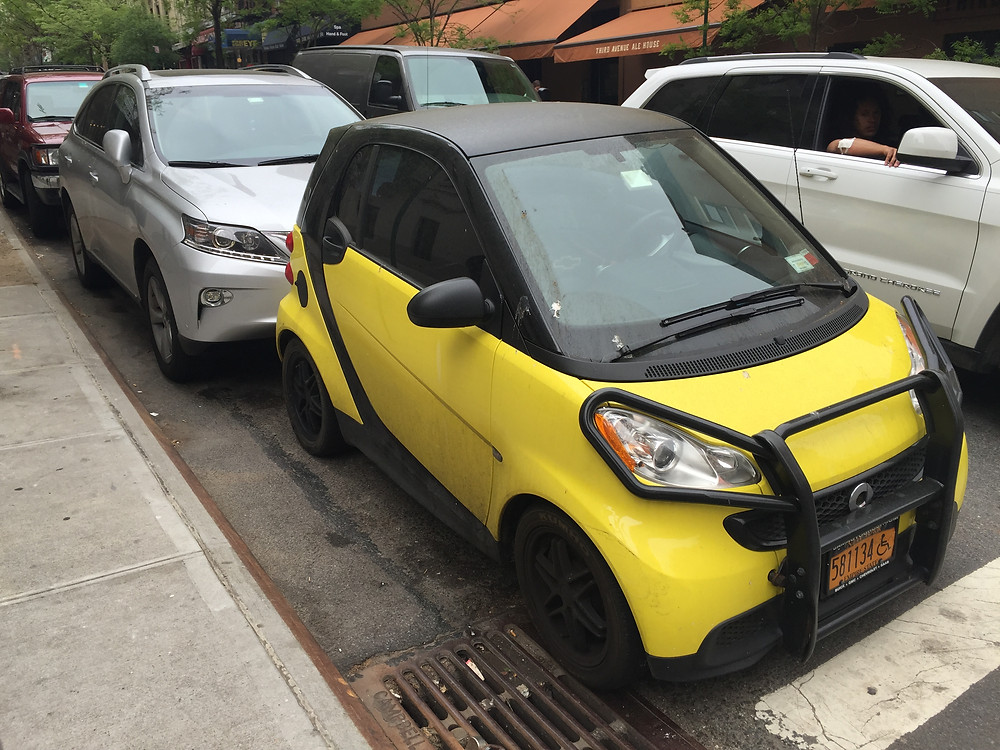 A dumb driver in a Smart Car parked against another car in NYC #3