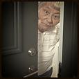 Elderly woman peaking out her front door, Doorways Etiquette Poll Category