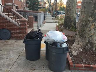 A Sidewalk Trashcan Barricade