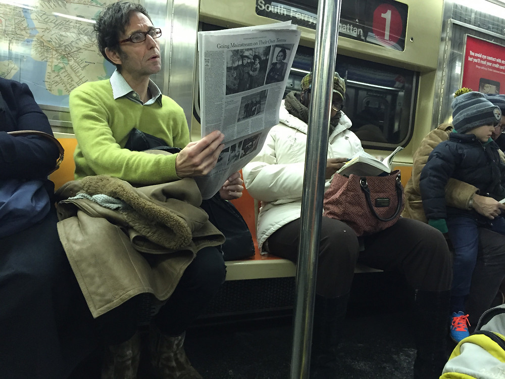Man hogging a seat with his bag and a woman manspreading on NYC 1 train 2