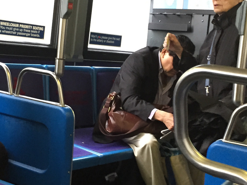 manspreading and bagspreading seat hog giving the elderly dirty looks in the priority seating