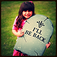 Girl with tombstone that reads I'll be back, Funeral Etiquette Poll Category