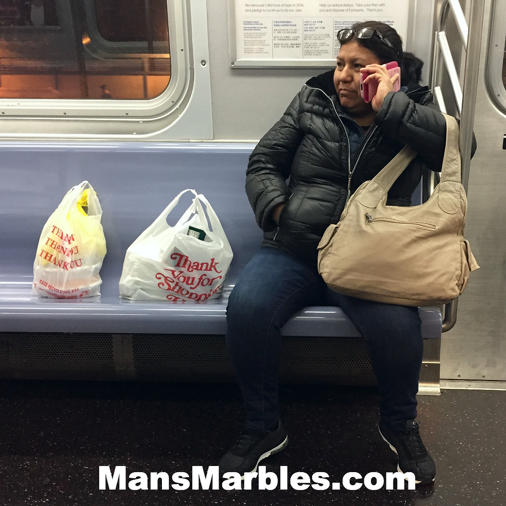 A womanspreader deliberately hogging seats with her grocery bags