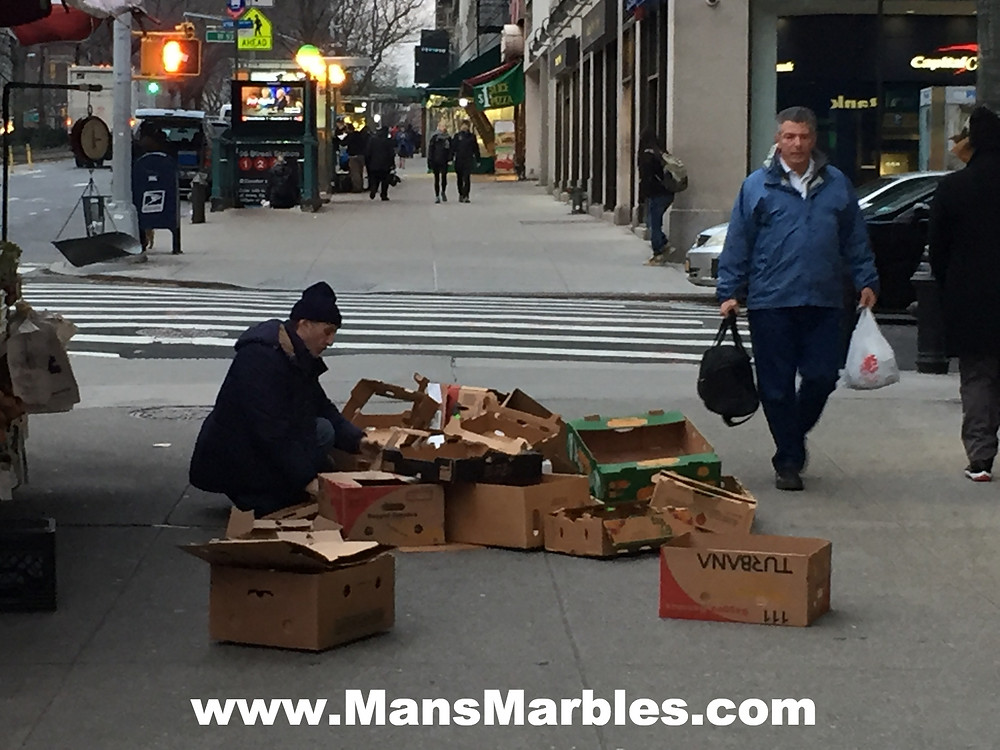Produce stand employee hogs entire sidewalk with empty boxes #2