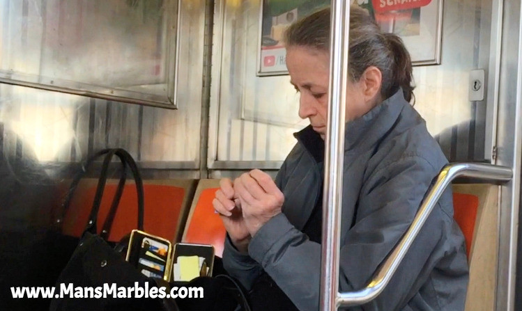 Gross woman clipping her nails on nyc 1 train