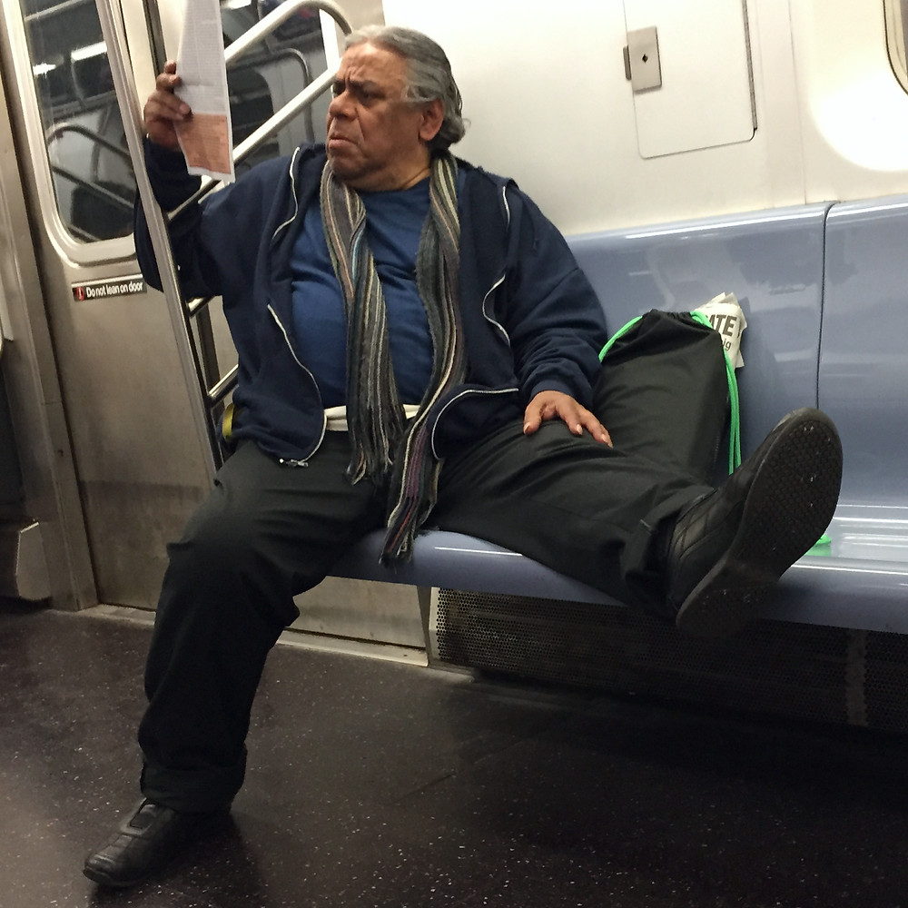 Manspreading with entire leg up on top of the subway seat