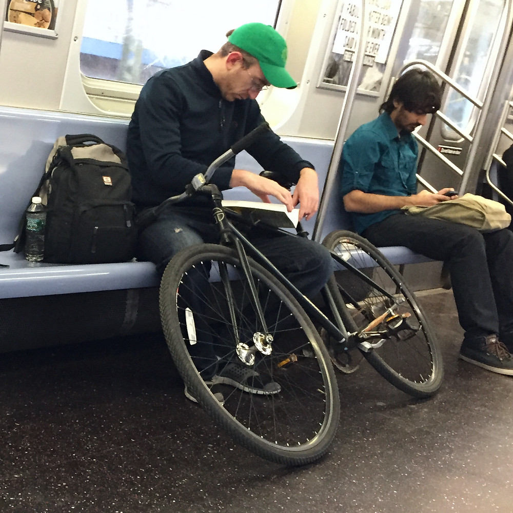 A hipster womanspreading, bagspreading, manspreading, and bikespreading in NYC #3