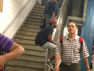 Rude Dude Sits on Staircase Hand Rail