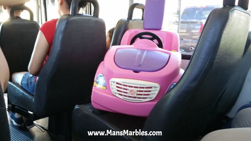 Mother hogs 2 seats with a child's toy car on NJ bus