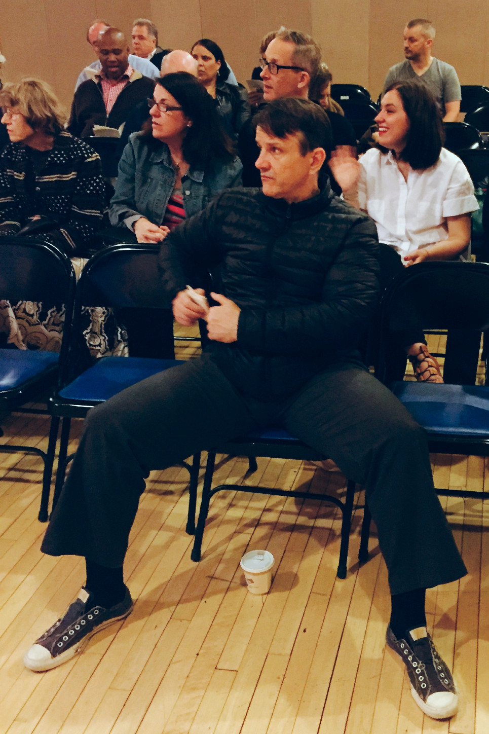 extreme manspreading in the front row at a play in NYC