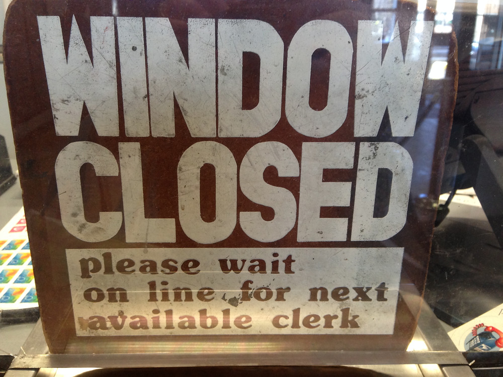 Sign in teller window states 'please wait on line.'  What the heck is 'on line!?'