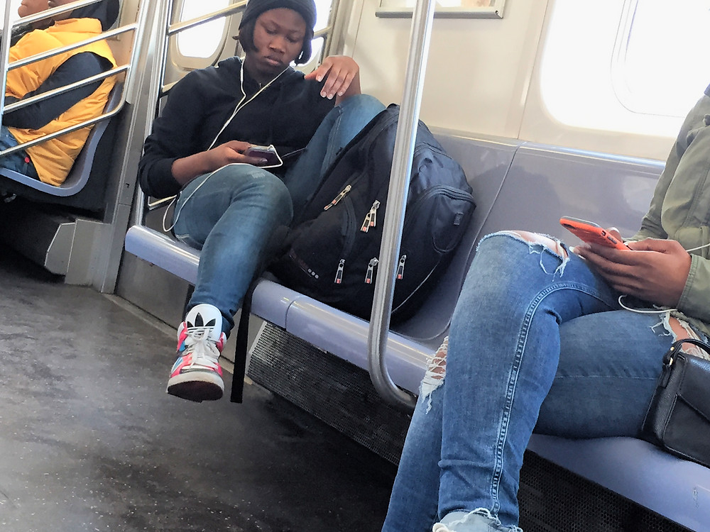 Womanspreading Bagspreading Girl with feet up on subway seat hogging a third place to sit with her bag #3