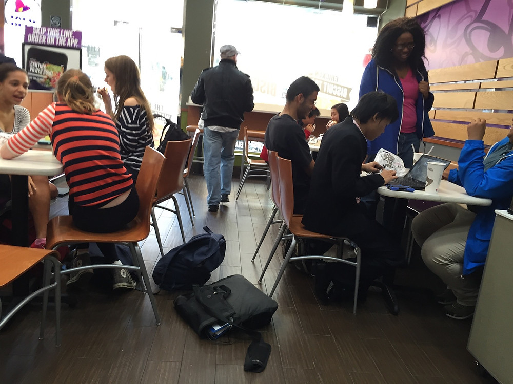 Students bagpreading on the floor in Taco Bell, forces man to step over them #5