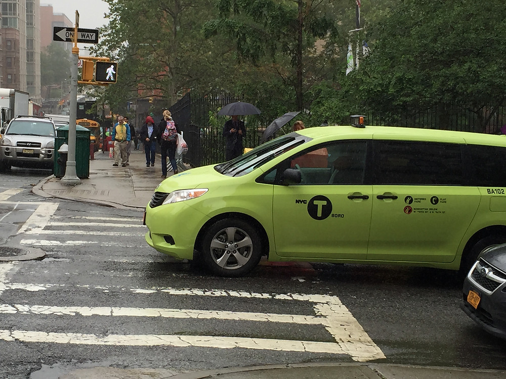 Cab driver stopped at red leight in pedestrian lane