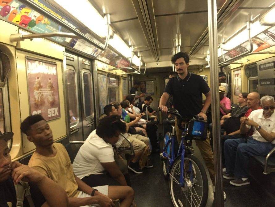 man obstructing passage with bike on nyc subway train