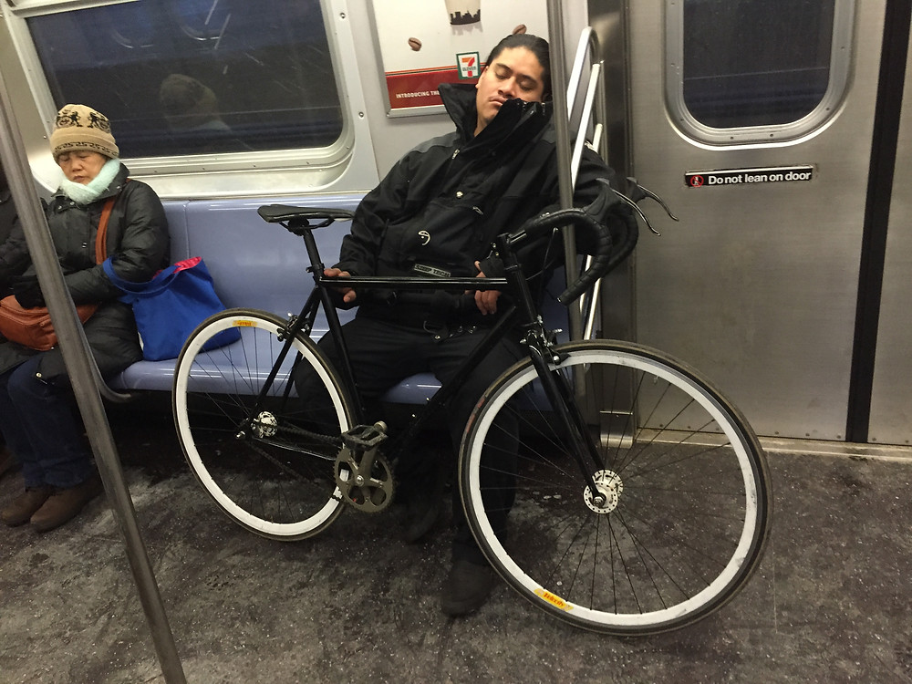 Manspreading and blocking seats with a bike on 4 train in NYC