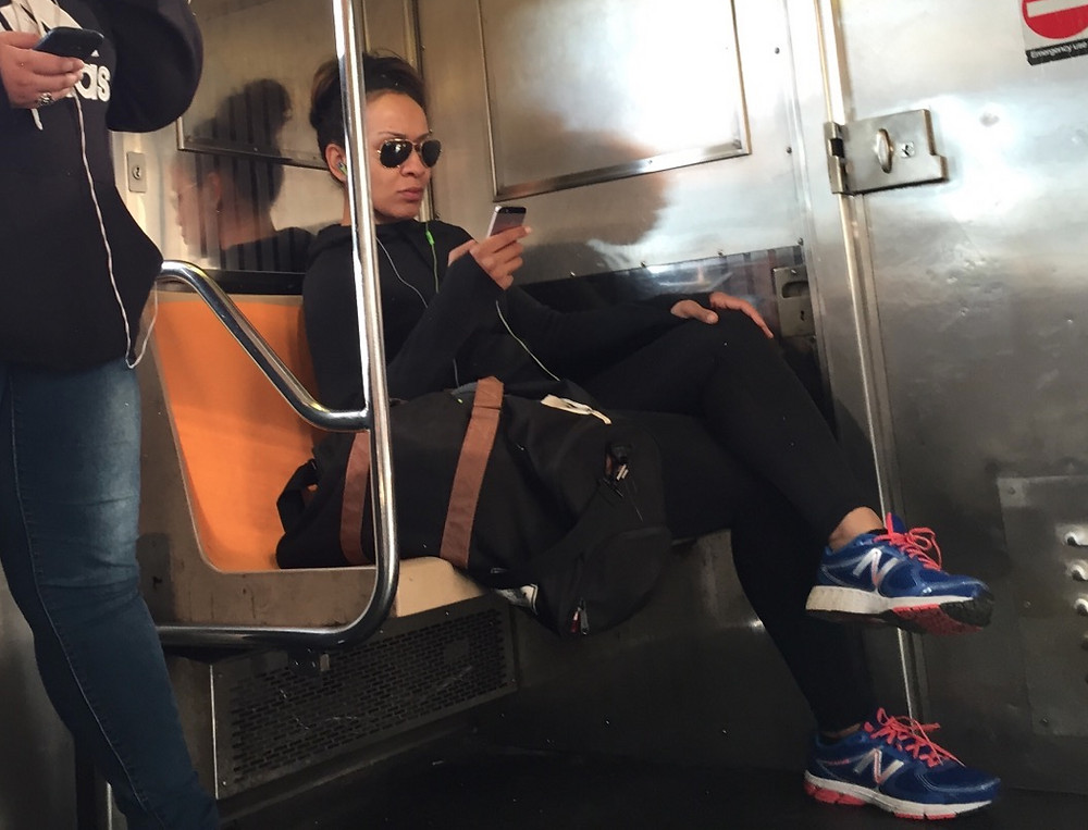 Tough looking girl Womanspreading on the 1 train #1