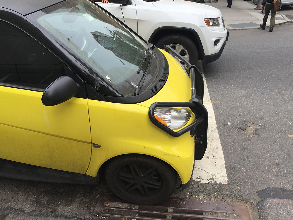 A dumb driver in a Smart Car parked against another car in NYC #4