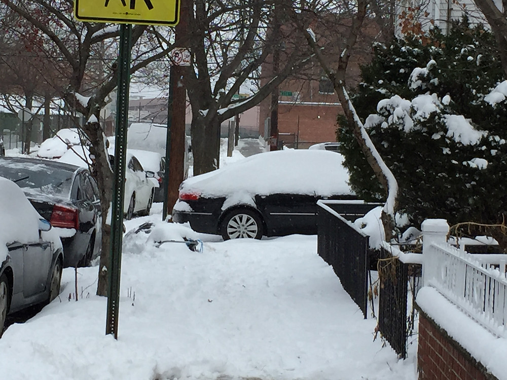 Jan 28, 2015, Car still parked on sidewalk after winter storm Juno, blocks pedestrians from walking safely