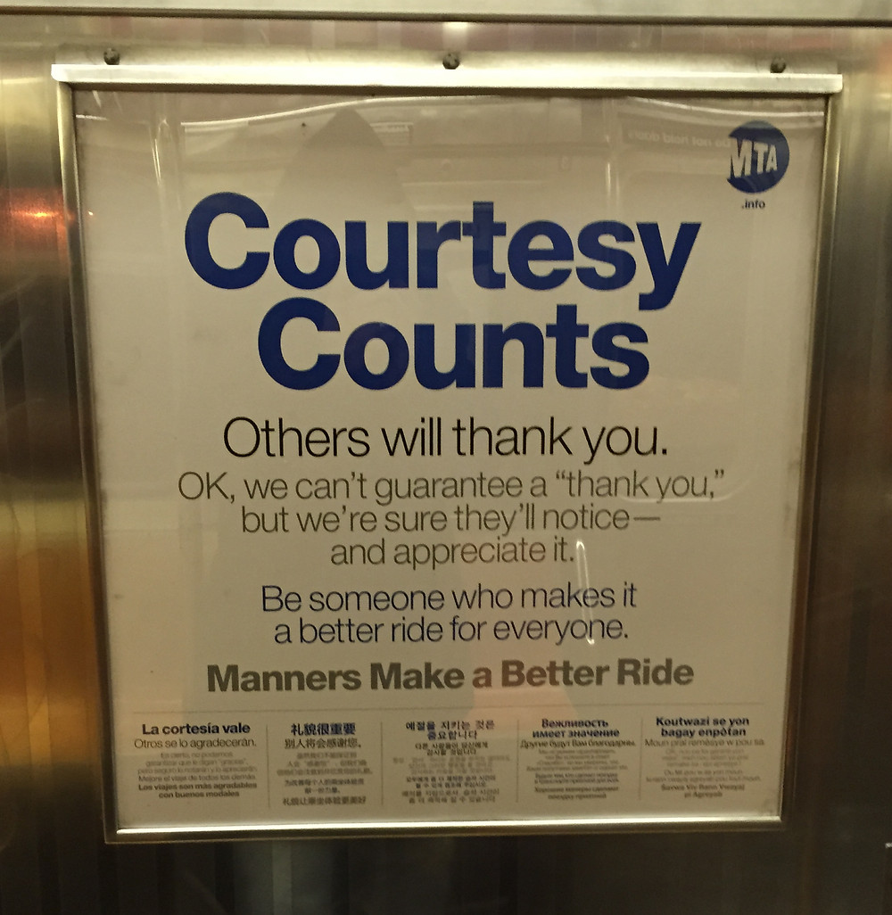 Picture of MTA's Courtesy Counts poster on the 1 train