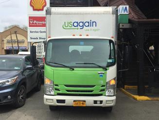 USAgain Truck Parked on Sidewalk