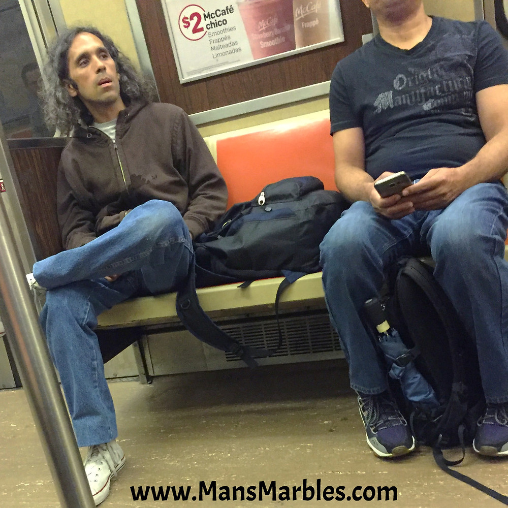 stoned manspreader stares a someone sitting properly with his jaw dropped
