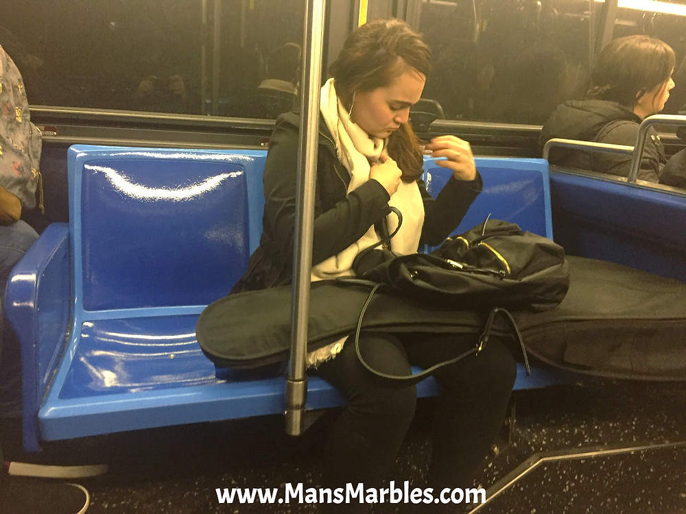 Womanspreading Guitarist hogs three seats on a busy bus in nyc